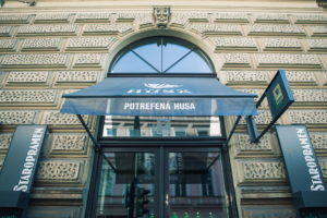 You cannot overlook the Potrefená husa restaurant in Hybernská street.