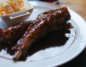 Leffe pork ribs made only in our restaurant according to the original recipe, slowly roasted in a dark beer sauce and served with coleslaw